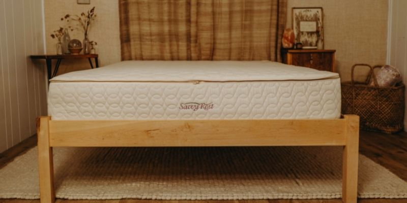 Natural platform bed made of sustainably-sourced wood.