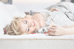 Bride resting on mattress