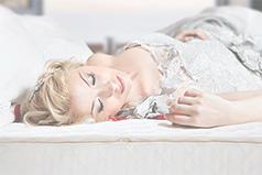 Bride resting on mattress