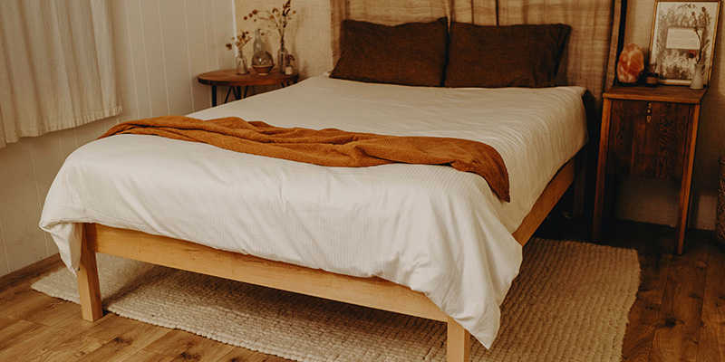 Rustic, boho bedroom with natural bedding.