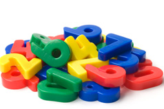 Plastic toy numbers in a pile