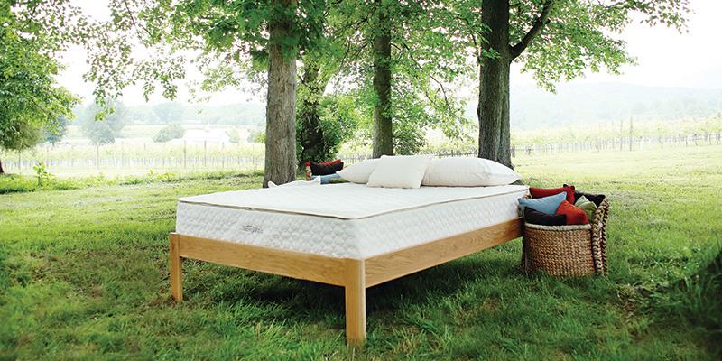 Innerspring mattress on a natural platform bed