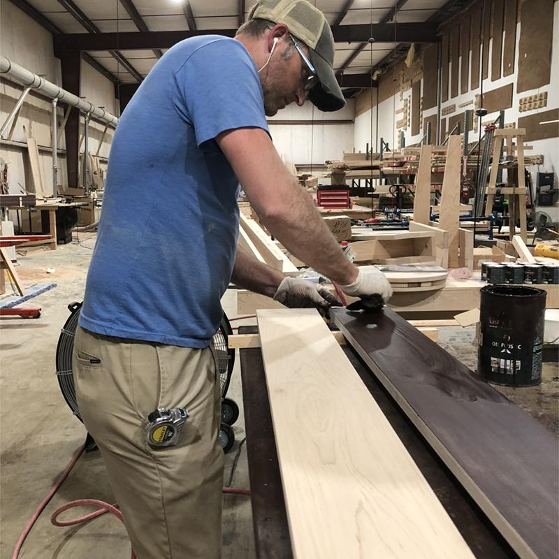 Staining sustainably-sourced maple hardwood.