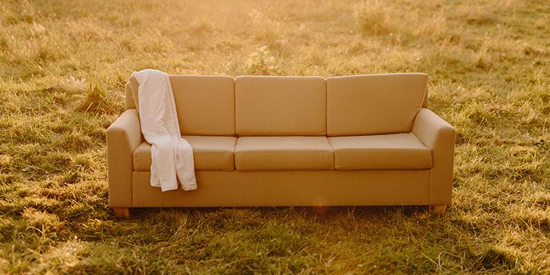Organic cotton throw blanket & natural sofa.