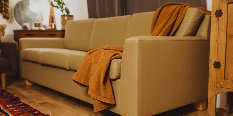 Organic sofa in cozy living room.