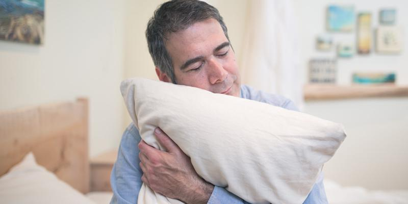 hugging a body pillow can help you sleep