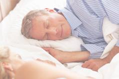 Man resting in bed