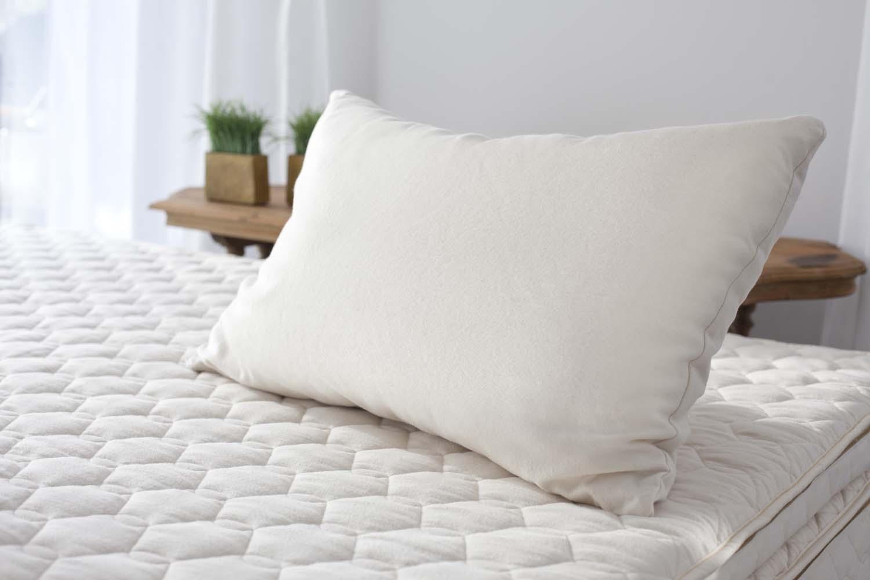Shredded latex pillow on an organic mattress