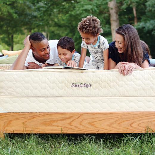 Family relaxing on Savvy Rest's Serenity mattress