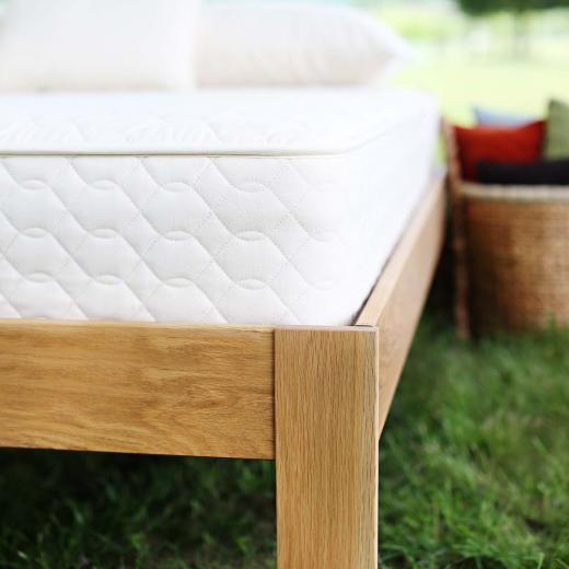 Innerspring mattress on a natural platform bed