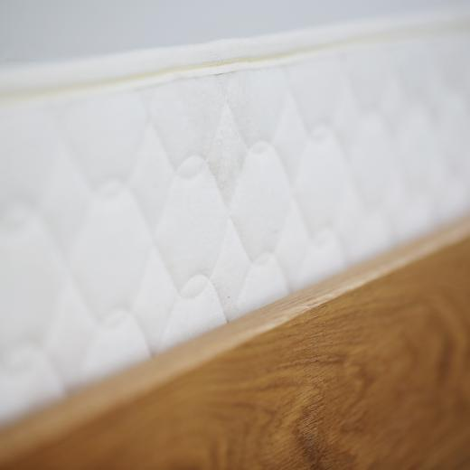 Savvy Rest Foundation in a wooden bed frame