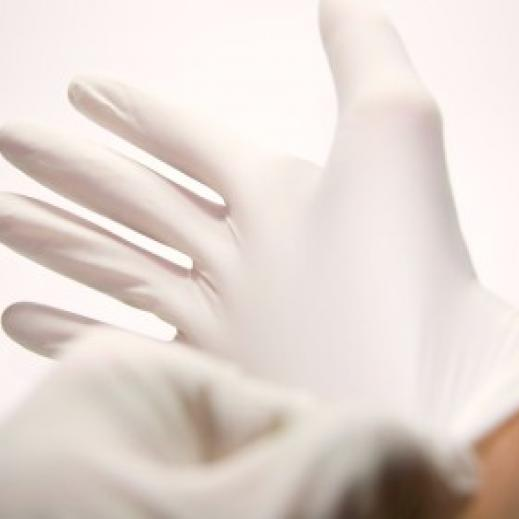 Putting on a latex glove
