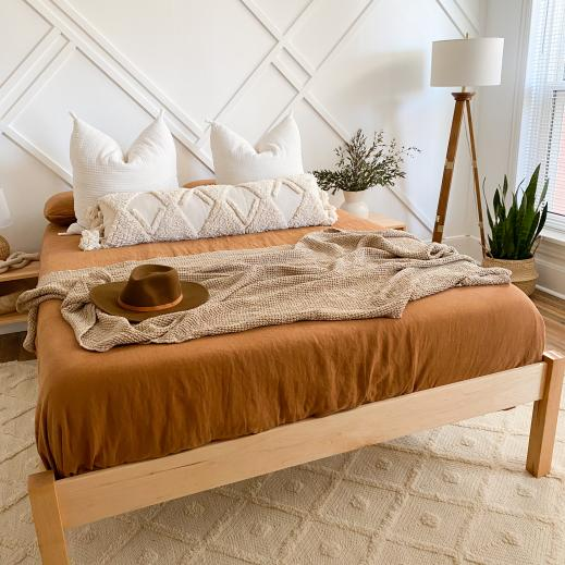 The Afton natural platform bed is perfect for any home decor style.