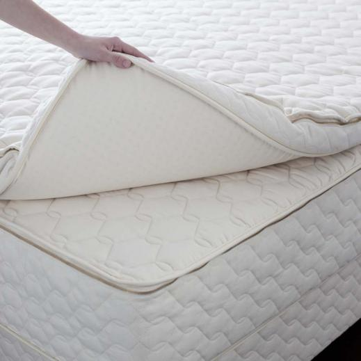 The Harmony organic latex mattress topper  stands four inches tall and is detachable