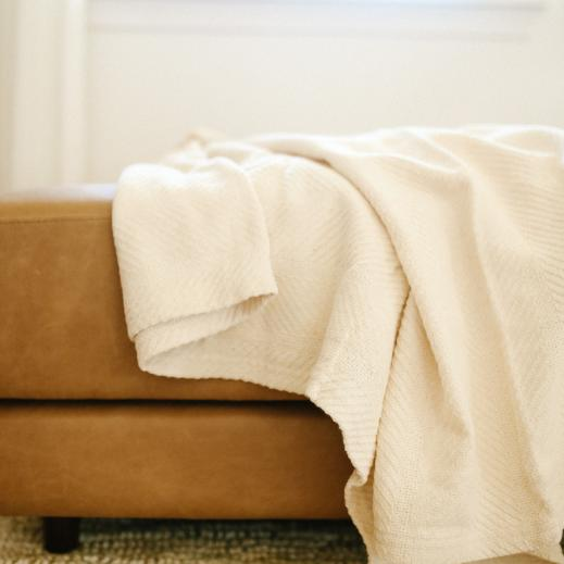 Organic cotton throw in Natural.