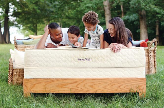 Family relaxing on Savvy Rest's Serenity organic mattress