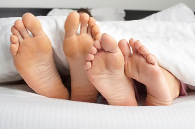 Couple lying down on their mattress