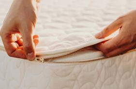 Unzipping a customizable mattress.